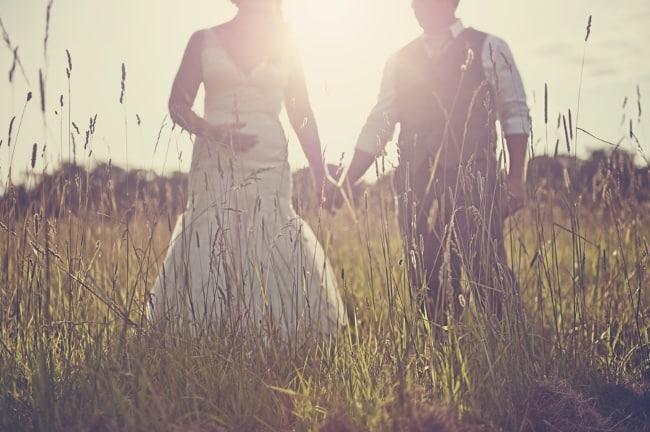 backlit sunset newlyweds