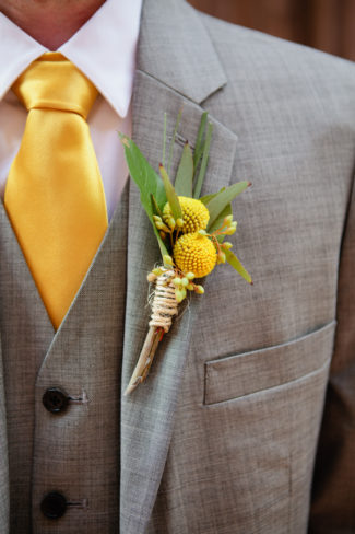 groom yellow necktie and billyball boutonniere