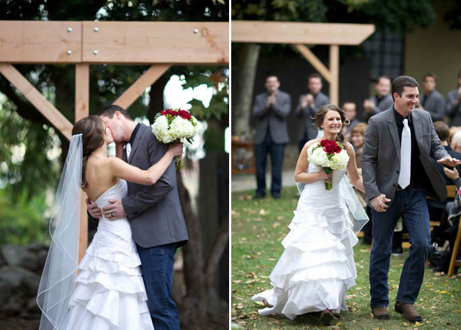 Bride and groom kissing after ceremony; ceremony backdrop groom's DIY idea