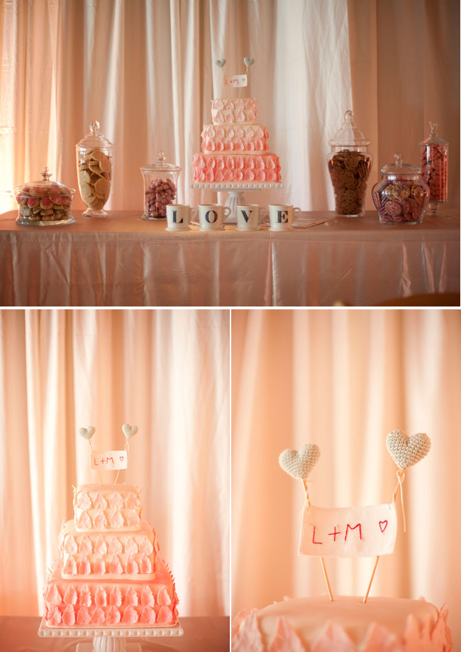 Dessert table with peach and white color wedding cake, hearts on a stick bunting cake topper