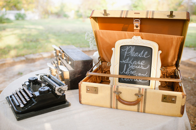 vintage suitcase and typewriter on guest book table