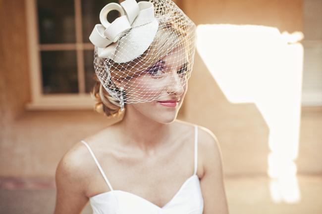 bride with birdcage veil with headpiece