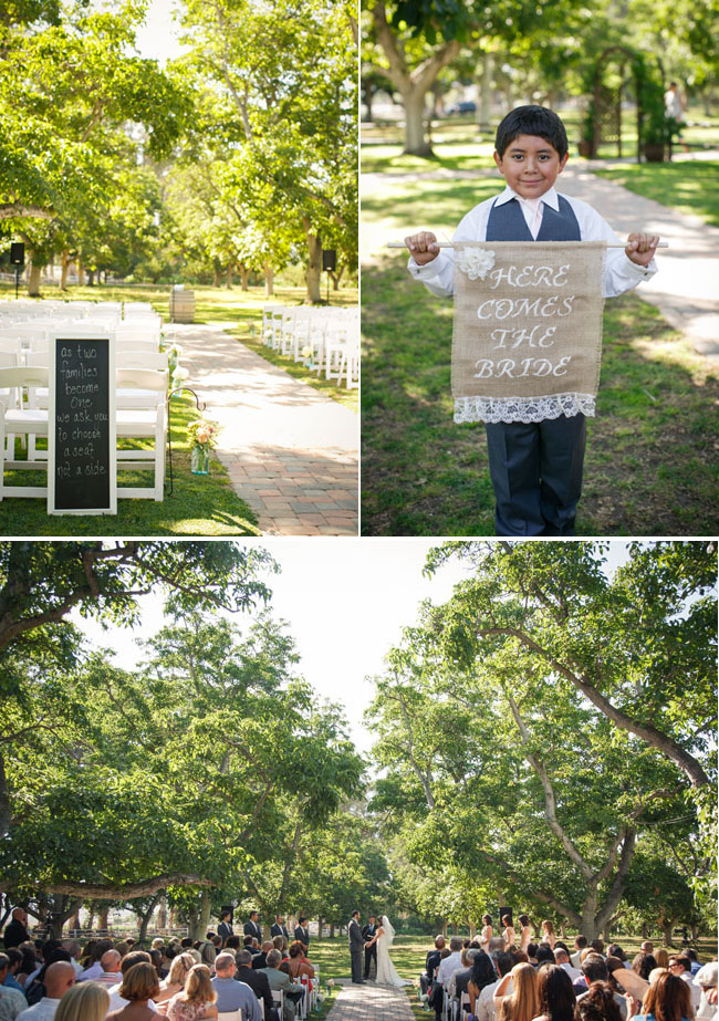 outdoor wedding ceremony at Walnut Grove with ring bearer holding burlap sign