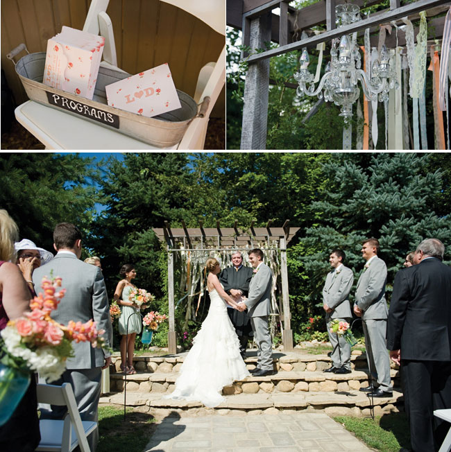 outdoor wedding ceremony at Millcreek Barn with pastel streamers behind bride and groom
