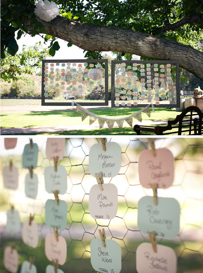 table seating notes in pastel colors hang from tree