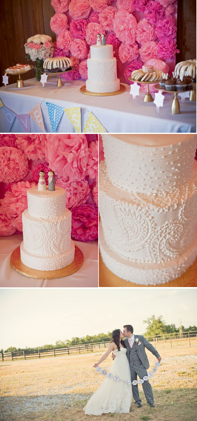 white dot wedding cake with pink tissue paper background on dessert table