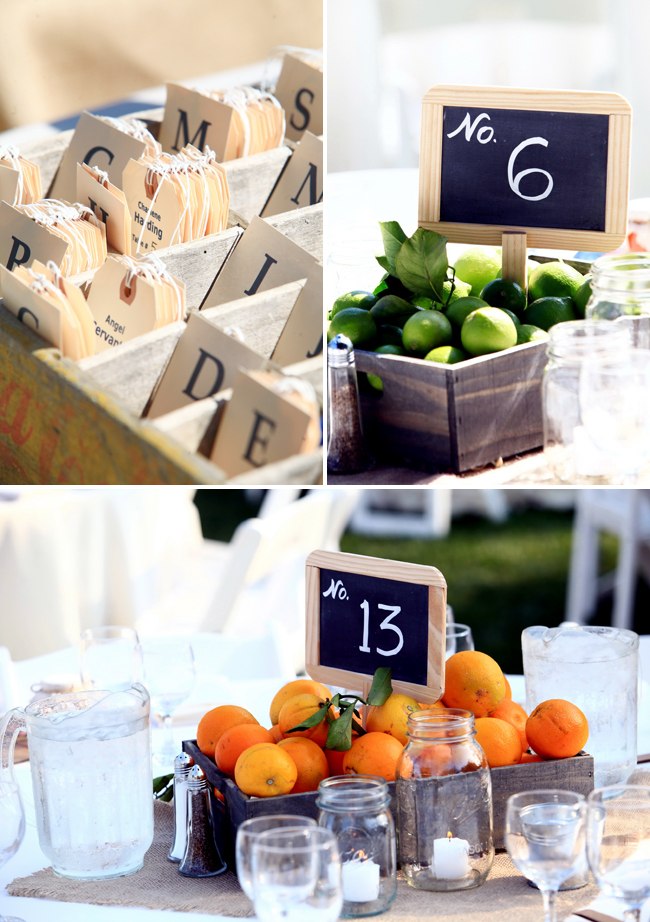 citrus themed wedding centerpiece with limes and oranges in wood crates