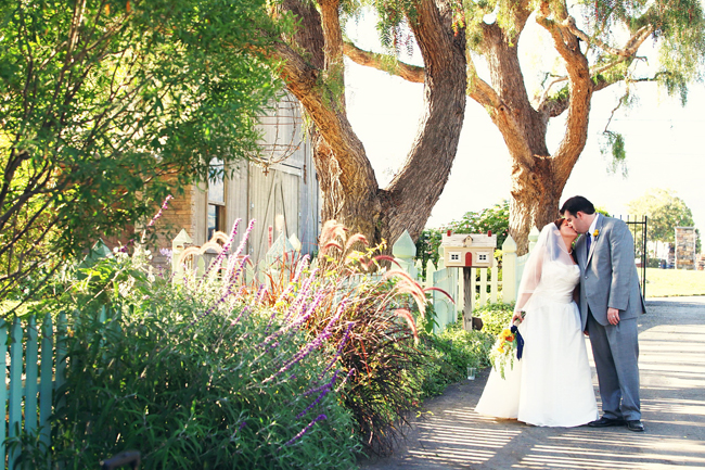 Gina and Ryan kiss while walking at Maravilla Gardens