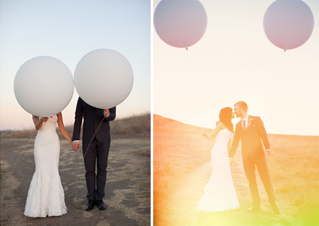 bride and groom hide behind white geronimo balloons