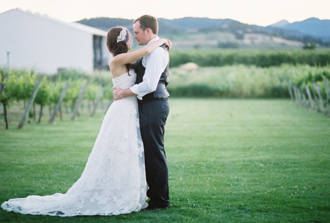 Bride and groom embrace in vineyards of Eden Vale Winery
