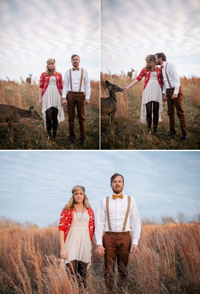 bride and groom feeding deer out of their hands in rustic elopement