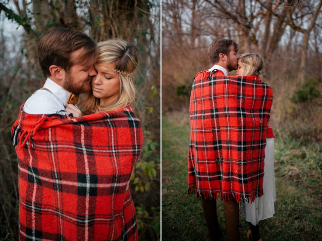 rustic elopement bride and groom snuggle together in red checkered blanket