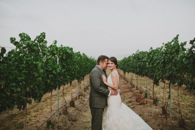 Bride and groom standing in vineyard field at Basel Cellars Estate Winery
