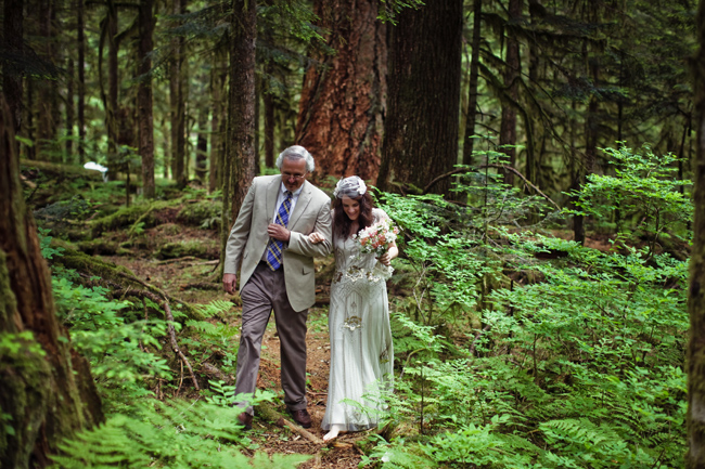 bride and father walk forest path at Mt. Baker wedding ceremony