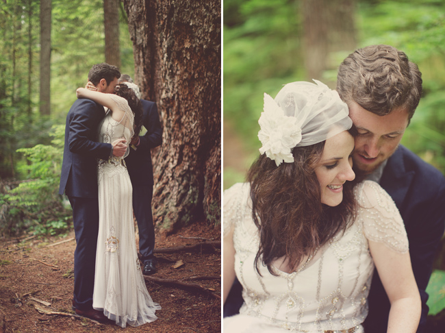 Bride and groom kiss at ceremony in the woods