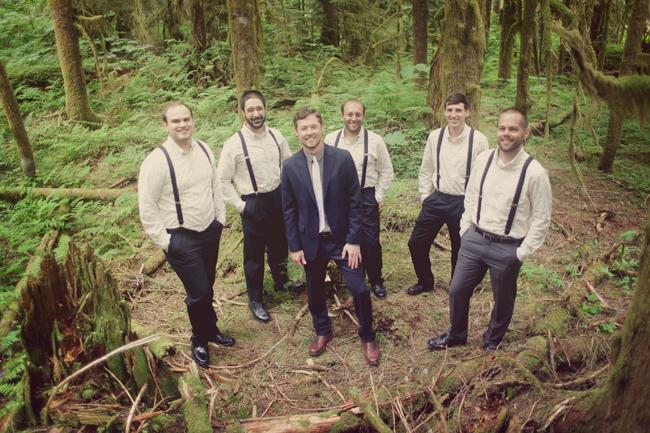groomsmen in suspenders amid Washington forest