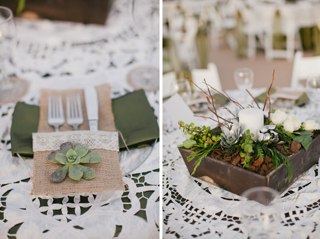 Succulents on burlap utensil holder with white lace tablecloth
