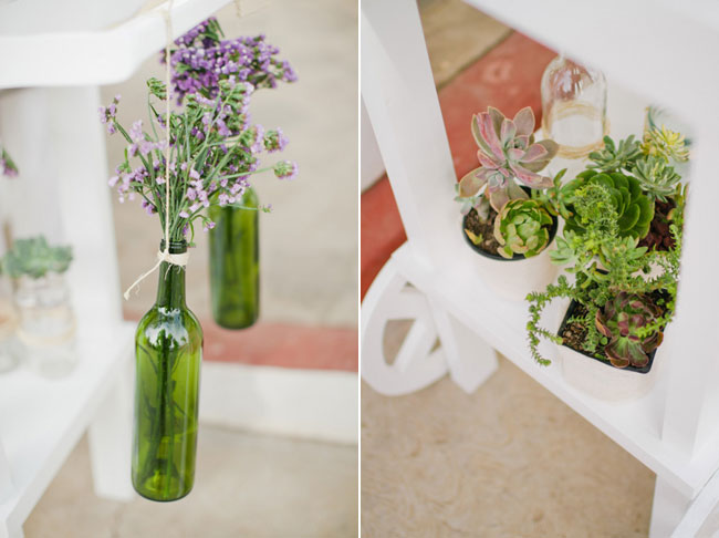 wedding decor: hanging green wine bottles and succulents on white tray