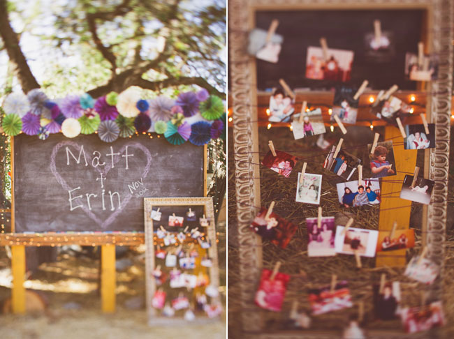 outdoor chalkboard wedding sign with mutli-colored pom-pom decor and clothespins with old photographs