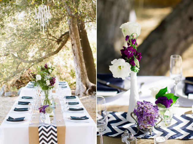 outdoor wedding reception table setting with white and dark purple flowers and black/white zigzag table running