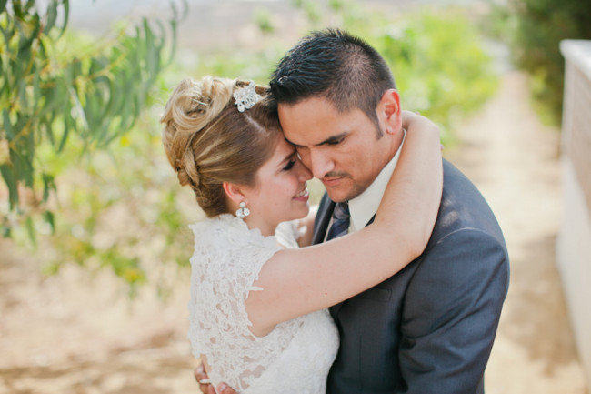 Bride and groom embrace at Quinta Casa Blanca