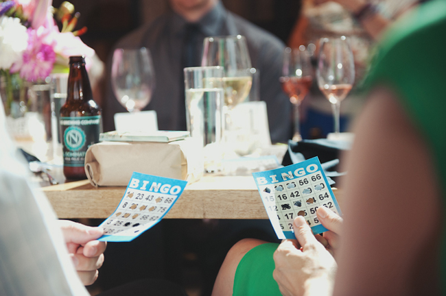 guests holding bingo cards for wedding at Cast Iron Studios reception