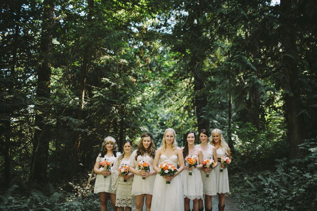 Woodsy Portland wedding bridesmaids dressed in white with orange bouquets