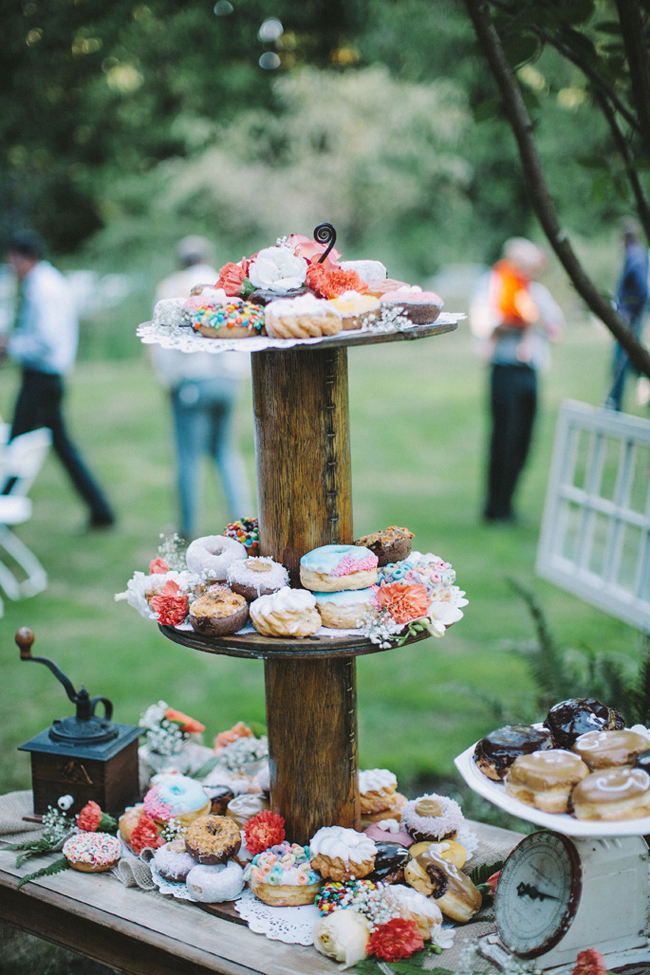 towering donut wedding cake on 3 tiers with wood center pole