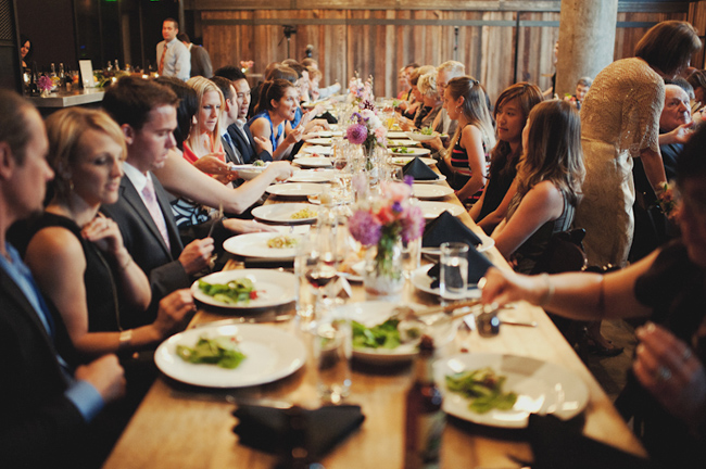 Cast Iron Studios wedding reception guests eating at long tables