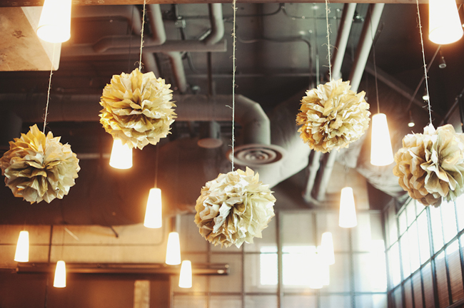 yellow pom poms hanging from Cast Iron Studios ceiling
