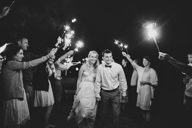 black and white photo of bride and groom sparkler exit