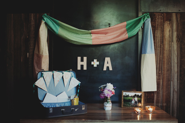 welcome table with vintage suitcase and striped fabric