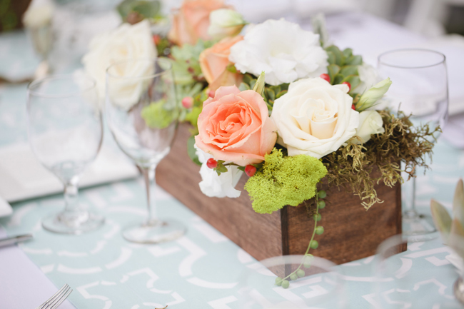 wooden box with coral roses as centerpiece