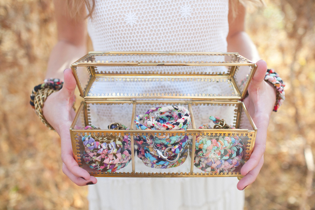 Sugar Blossom Design jewelry bracelets stacked in clear gold rim box