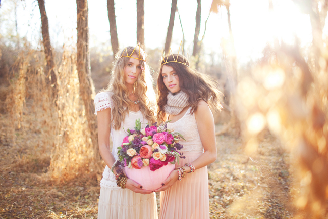 bohemian models hold pink pumpkin centerpiece
