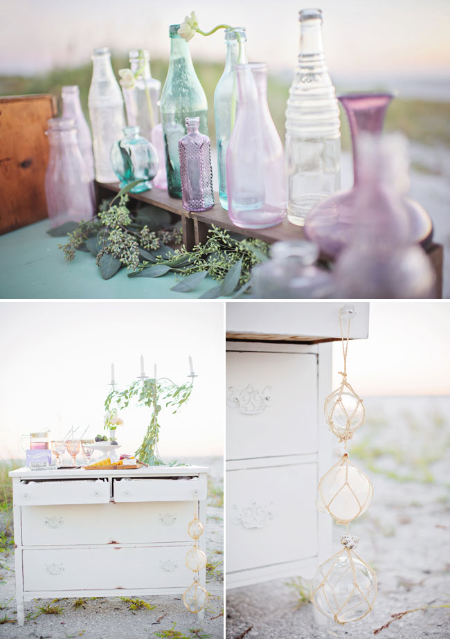 colored glass bottles with distressed furniture and decor on dreamy beach shoot at Don Cesar Beach Resort