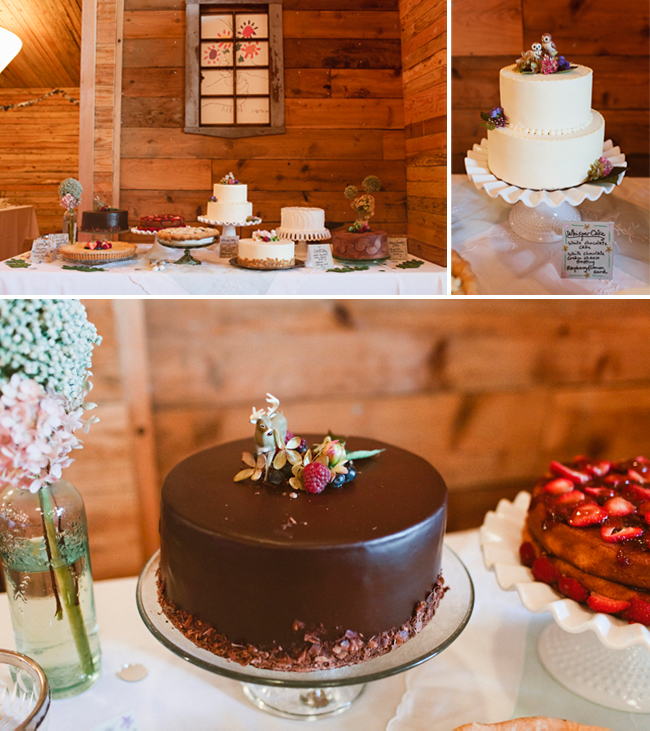 Indoor dessert table with chocolate cake, two-tier white wedding cake, and other desserts