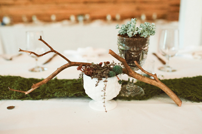 centerpiece with moss table runner and mini potted plants