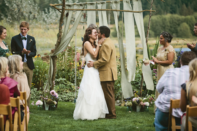 bride and groom kiss at wedding ceremony outdoors on Whidbey Island