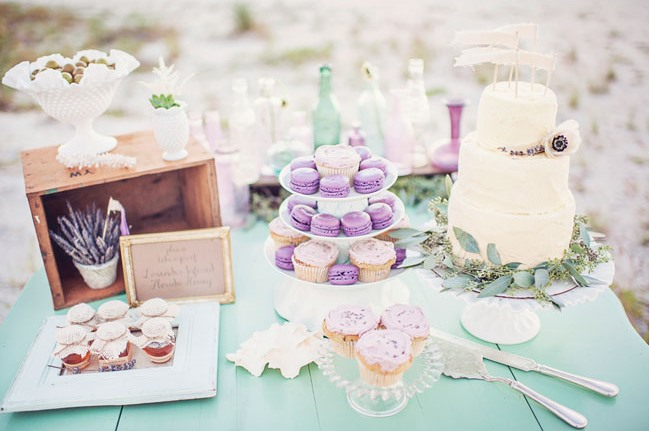 lavender macaroons and acake on mint color dessert table cloth