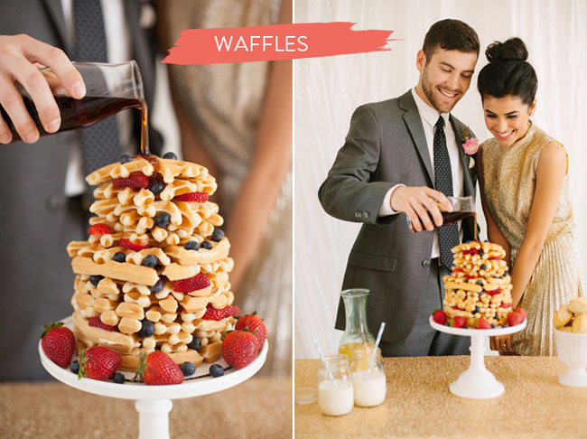 bride and groom poor syrup on waffle wedding cake with strawberries and blueberries