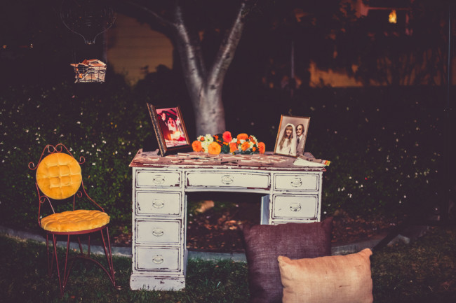 antique desk and pillows on grass outside