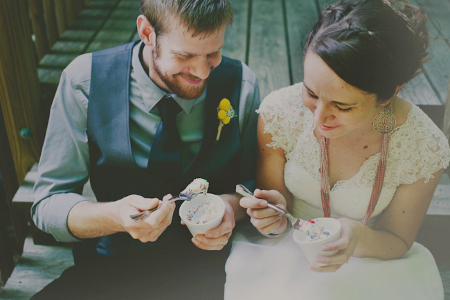 groom and bride eating ice cream