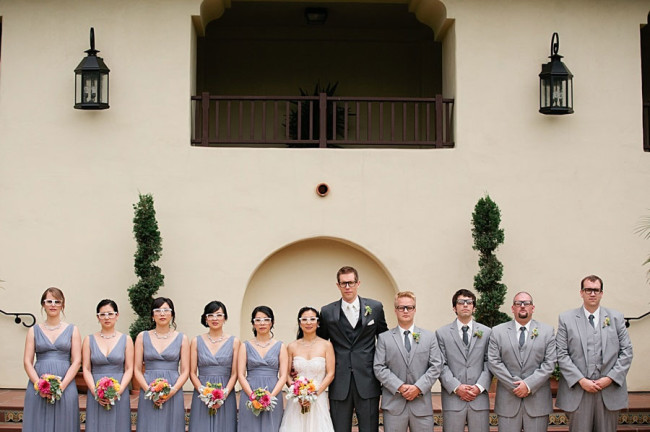 Scripps Seaside Forum wedding party in a row wearing glasses