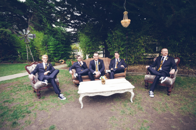 groomsmen on vintage furniture outdoors