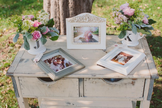 framed pictures on vintage desk, outdoors on the lawn