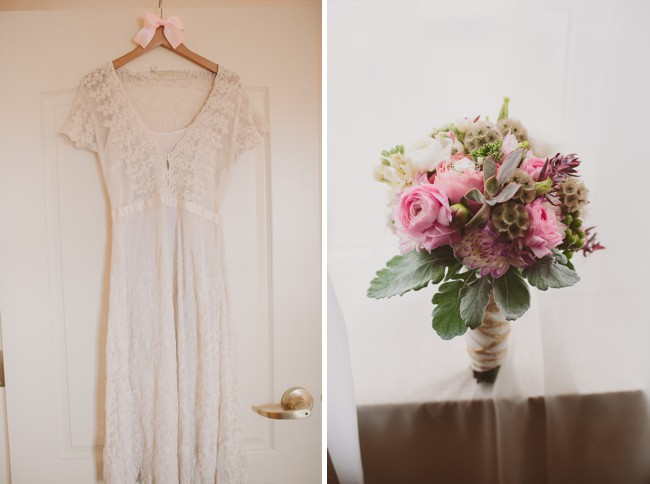 hanging dress and bouquet on table