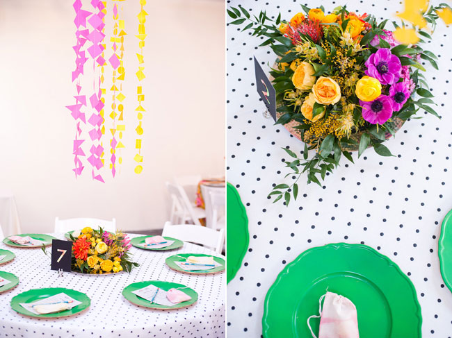 green plates with colored flower centerpiece