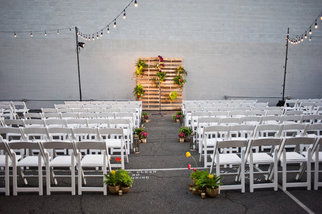 indoor wedding ceremony against white brick wall