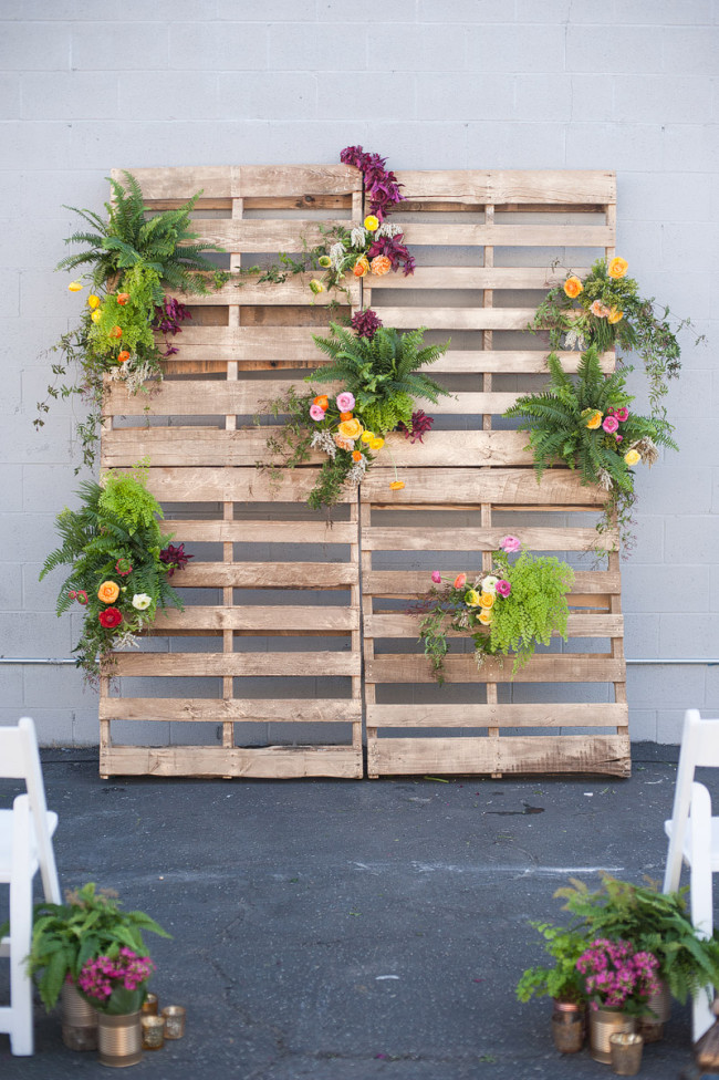 wood pallets with florals as wedding backdrop